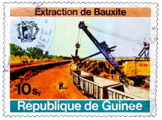 "Stamp ""Bauxite in Guinea"". © Shutterstock"