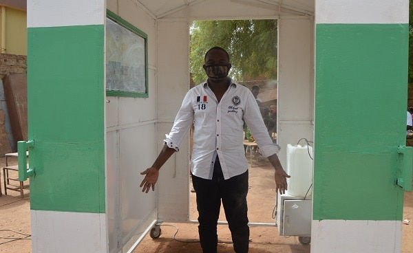BURKINA FASO: Young entrepreneur manufactures solar-powered body disinfector©Mahomed Billa